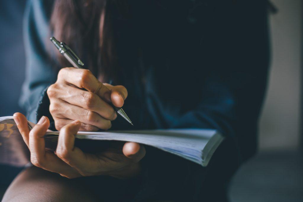 girl writing passionately