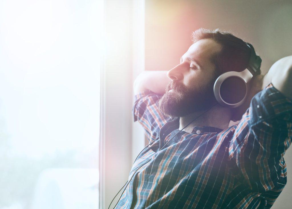 man enjoying the music sitting