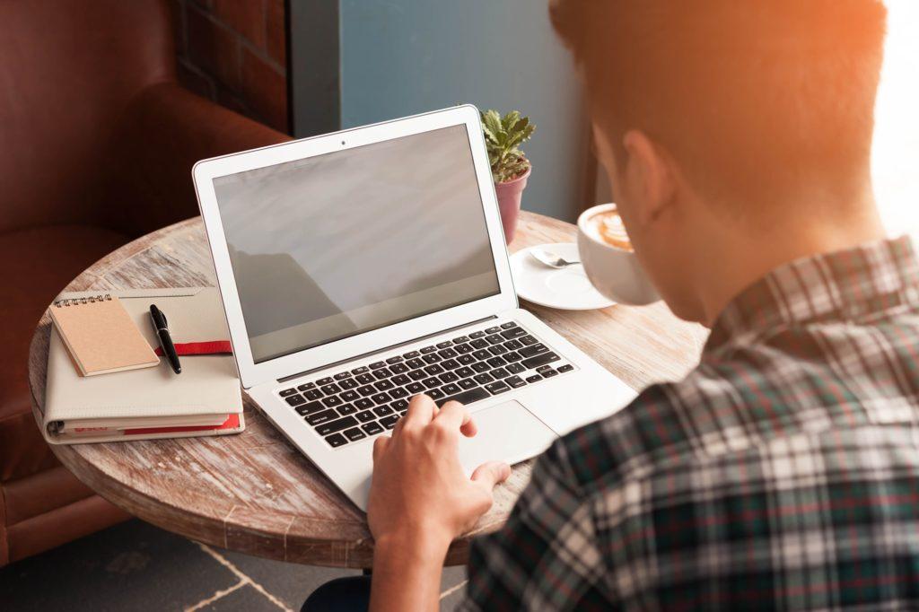 man reading his work laptop