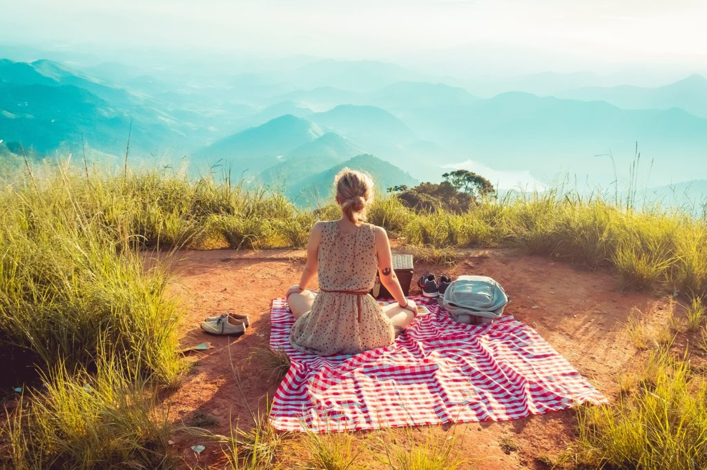 girl enjoying the view of mountains
