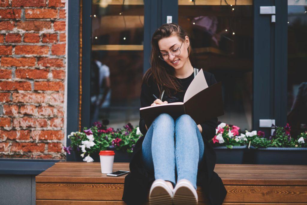 woman enjoys writing outside